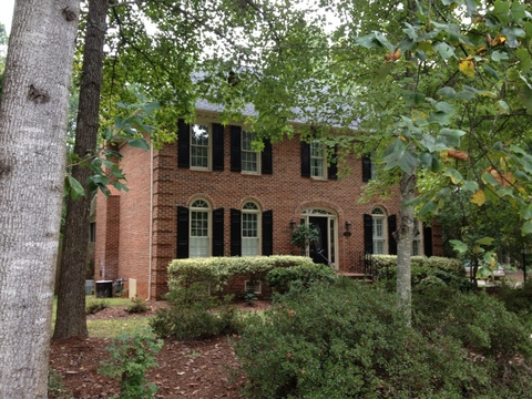 Wooded lots, all brick home providence plantations